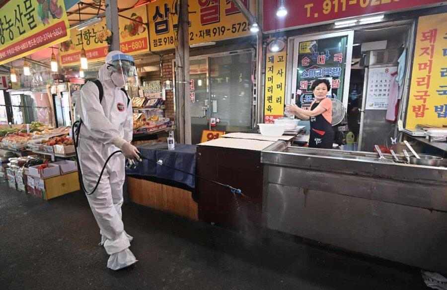 عکس روز ، ضدعفونی بازار در سئول